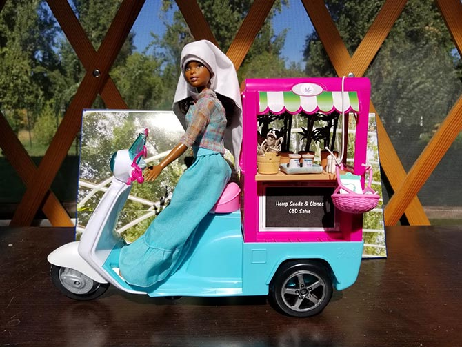 black doll dressed like nun on a bike sells cbd